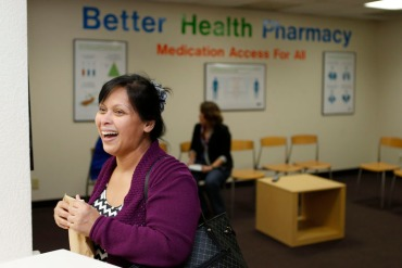 Jinky Balane, 53, picks up asthma medicine for her son at the Better Health Pharmacy, which is staffed by volunteer pharmacists and run by the Santa Clara County Public Health Department in downtown San Jose, Calif.ornia on Feb. 10, 2016. The surplus drug redistribution program is the first in California. (Josie Lepe/Bay Area News Group)