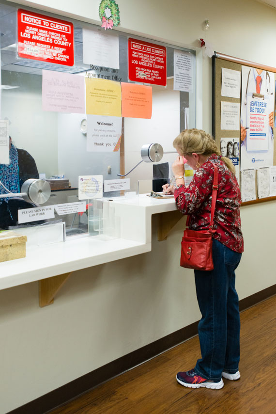 Eileen Bachemin, 50, signs in for her appointment at the San Fernando Mental Health Center in Granada Hills, California, on Monday, February 8, 2016. (Heidi de Marco/KHN)