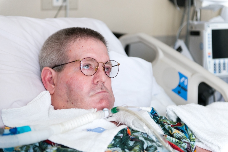 John Wilson, 61, at St. John's Pleasant Valley Hospital in Camarillo, Calif., on Wednesday, February 24, 2016. Wilson has ALS, a degenerative neurological disorder commonly known as Lou Gehrig's disease, and needs a ventilator to breathe. (Heidi de Marco/KHN)