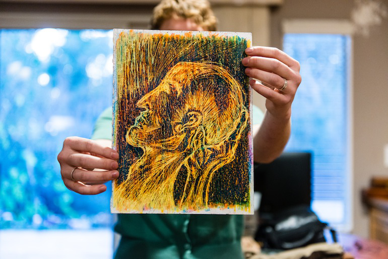 Amanda Lipp holds up one her art pieces on Tuesday, December 15, 2015. Art helped her with cope with her depression (Heidi de Marco/KHN).
