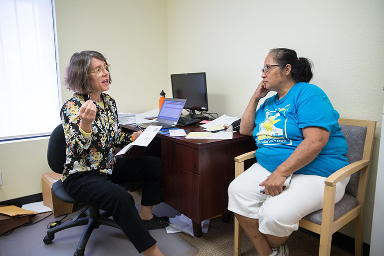 Laura Castillo, right, learns about treatment of her hepatitus C infection from Dr. Katie Moizeau Thursday, March 3, 2016 during a weekly clinic in Sacramento.