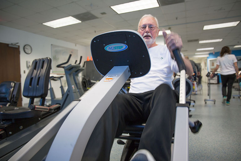 Charles Greiner works out at the University of Virginia Health System's cardiac rehabilitation gym in Charlottesville, Va. (Francis Ying/KHN)