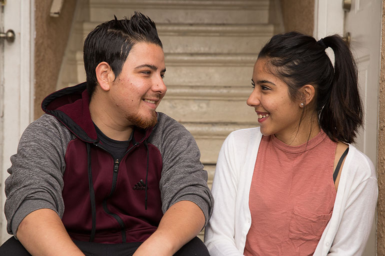 Tapia and his sister, Alma, 24. Tapia's family noticed his improvement from the exercise and computer training. (Courtesy of the University of California, Los Angeles)