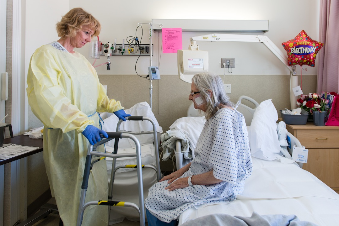 Nurse specialist Annelie Nilsson checks on Prochazka during her stay at the San Francisco General Hospital on Thursday, March 24, 2016. (Heidi de Marco/KHN)