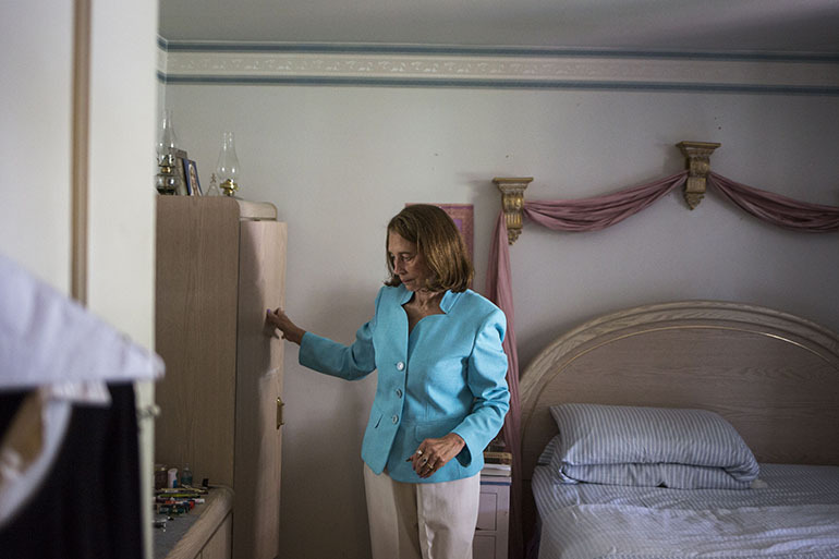 PACE, a program to help keep older people out of nursing homes, allows Vivian Malveaux, 81, to live at home in Denver. InnovAge, which runs her program, converted to a for-profit company last year. (Nick Cote for The New York Times and KHN)