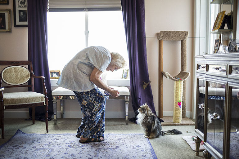 "Kathy Baron with Munchkin. Baron was left disabled by breast cancer and nerve pain. InnovAge has made it possible for her to stay in her home. ""I would rather be dead than go into a nursing home,"" she said. (Nick Cote for The New York Times and KHN)"