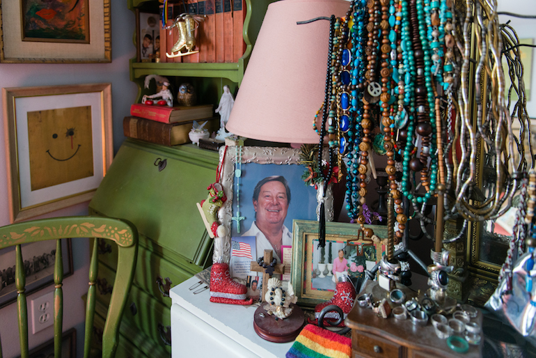 A photo of Ed Dehag's partner sits on the dresser in his bedroom at the Triangle Square Apartments in Los Angeles, California, on August 16, 2016. Dehag moved into one of the apartments shortly after his partner passed away. (Heidi de Marco/CHL)