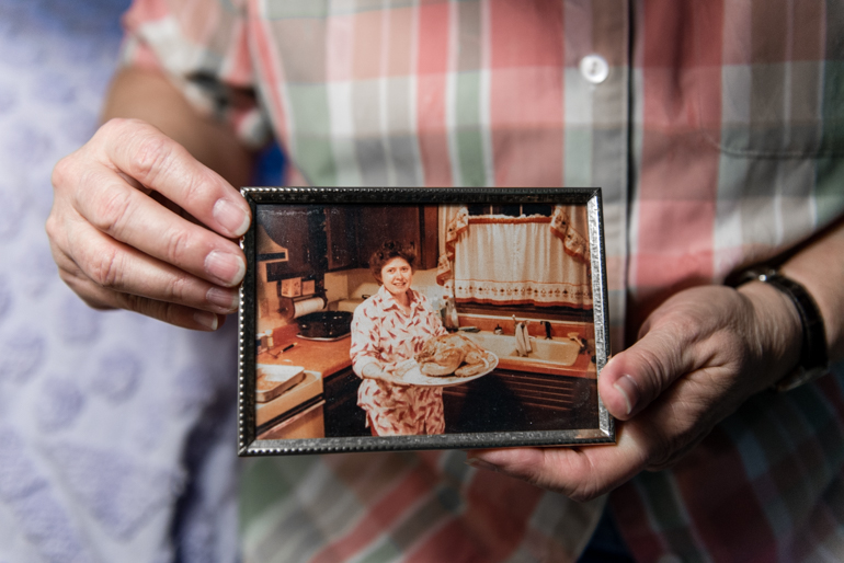 Lee Marquardt, 74, holds an old photograph of herself in her bedroom at the Triangle Square Apartments in Los Angeles, California, on August 16, 2016. Marquardt, a former truck driver who has high blood pressure and kidney disease, came out after raising three children. (Heidi de Marco/CHL)