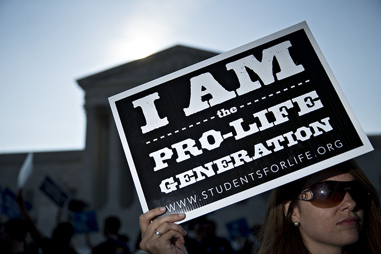 An anti-abortion advocate holds a sign outside the U.S. Supreme Court before rulings in Washington, D.C. on June 27, 2016. (Andrew Harrer/Bloomberg via Getty Images)