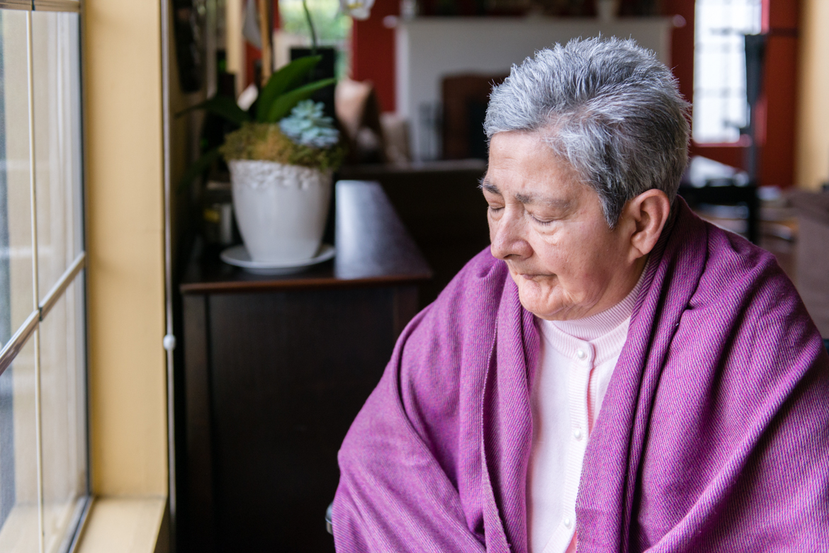 Blanca Rosa Rivera, 76, sits in front of the dining room window of her daughter's house in North Hollywood, Calif., on Sunday, November 27, 2016. Rivera was diagnosed with Alzheimer's in 2004. (Heidi de Marco/California Healthline)