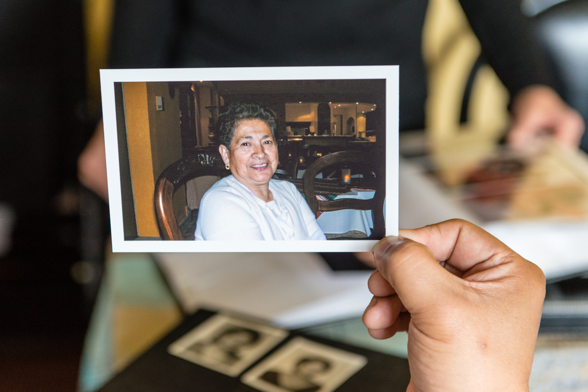 Mario Yanes holds a photo his mother, Blanca Rosa Rivera, a few years before she was diagnosed with Alzheimer's disease. (Heidi de Marco/California Healthline)