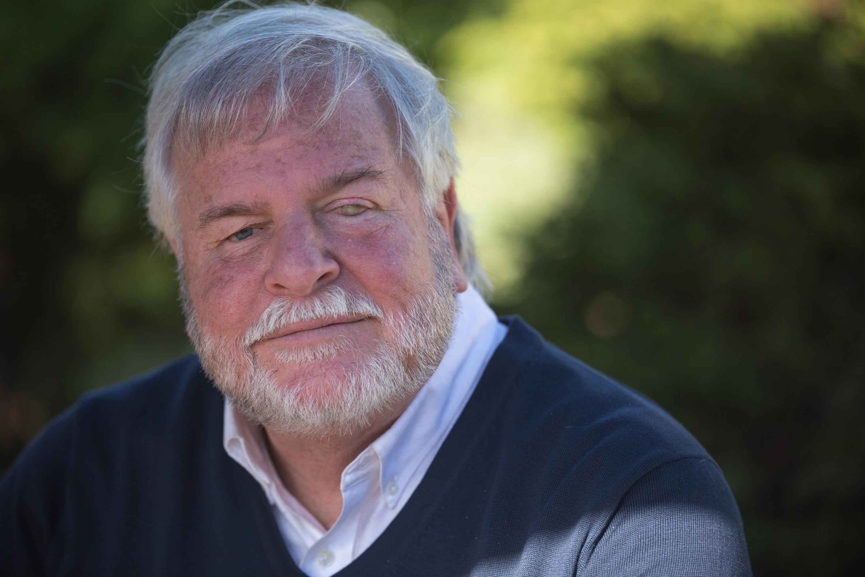 close up of senior man with grey hair and beard