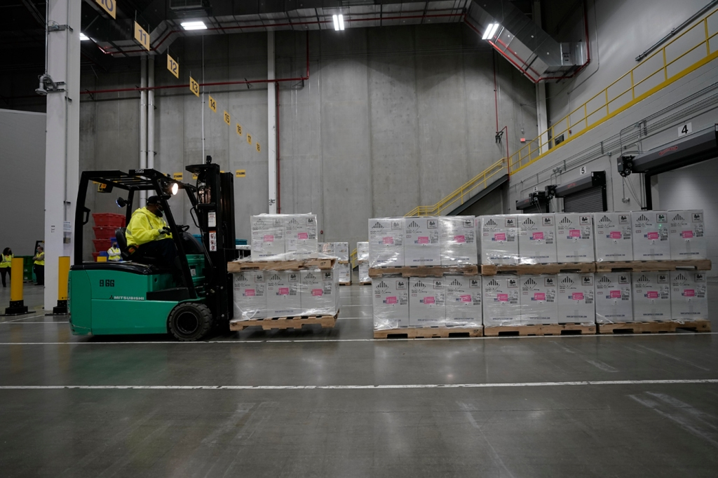Image of the first shipments of the Pfizer and BioNTech covid-19 vaccine transported for shipping