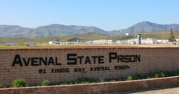 large sign reading Avenal State Prison