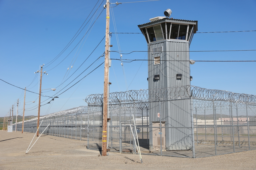 prison tower with barbed wire fence