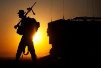 A machine gunner prepares to load an amphibious assault vehicle.