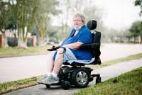 Maria Skladzien sits in her wheelchair on a sidewalk