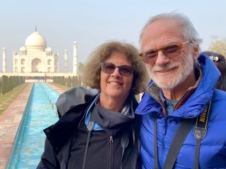 two seniors pose in front of the Taj Mahal