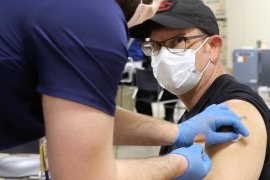 A man receives a COVID-19 vaccine