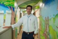 portrait of Dr. Eric Berger standing in his pediatric practice