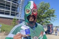 Jesus Romero Serrano holding vaccination promo