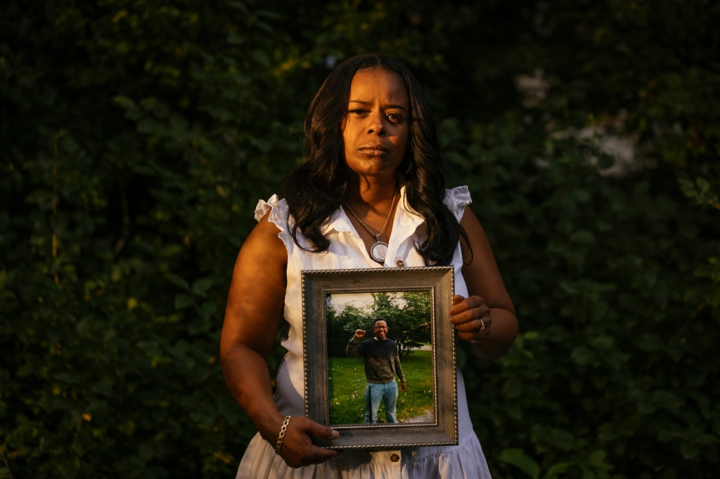 Rafiah Maxie holds a photo of her son, Jamal Clay